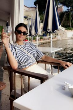 Kendall Jenner wearing Le Specs X Adam Selman the Last Lolita Sunglasses, Solace London Resort 2017 Bella Top in Navy Stripe and Solace London Ray Trousers