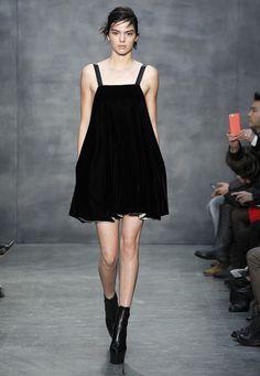 LOOK 38. Black fluid velvet bubbled hem dress with webbing straps.