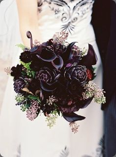 @Leeann Loui what do you think about this idea??? The dark flowers for our black dresses... instead of white or red. Thoughts???