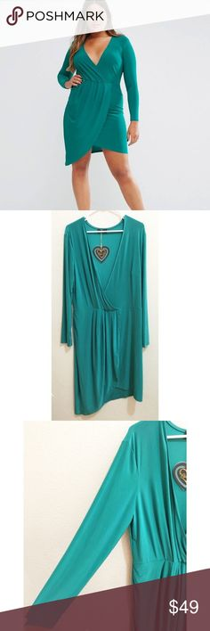 """NWT ASOS Club L Size 20 Jade Green Wrap Dress Brand new with tags jade green slinky dress with wrap front by Club L from ASOS. UK size 24, which is a US 20. Soft and stretchy with an asymmetrical hem line and v neck. Elastic band at waist. Only out of manufacturers packaging for photos, but does have a broken stitch at waist wrap hem. 95% polyester/5% elastane. All measurements approximate, and dress is very stretchy: bust (taken to the best of my ability as this is a deep open V) 47""""…"""