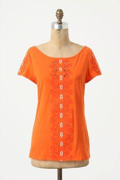 Orange shirt. pretty cut outs