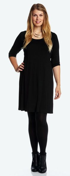 Dress it up or dress it down however you please—this comfortable stretch-jersey dress offers infinite versatility. Three-quarter sleeves finish the easy yet flattering A-line cut.