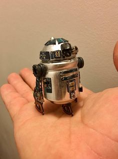"This ""Capacitor Droid"" was commissioned from parts from a motherboard, a few dead hard drives, and other various parts. 3 x3 x3 Case included."