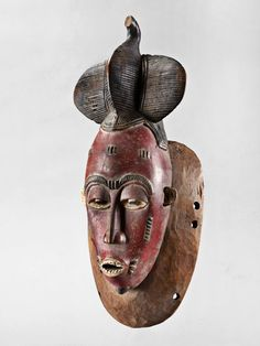 Baule Kpwan Mask, Ivory Coast http://www.imodara.com/item/ivory-coast-baule-goli-entertainment-mask-kpwan-mother/
