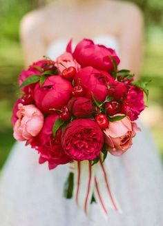 6. Go ultra-glam with deep red peonies. This dark toned flower adds tones of depth to a floral arrangement and is incredibly elegant. #WeddingBouquet