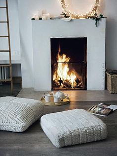 knitted cushions and gorgeous fireplace