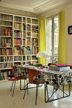 Love the bookshelves and yellow curtains