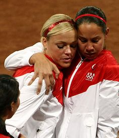 Cat Osterman & Jennie Finch in August 2008 Beijing Olympics right after Cat lost the Gold Medal game