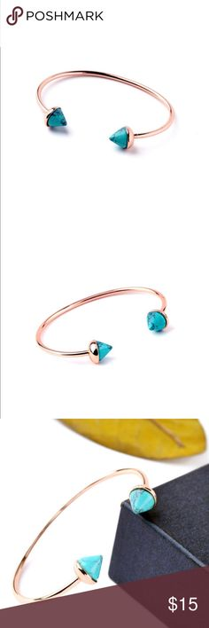 J. Crew Rose Gold and Turquoise Open Cuff Bracelet Rose gold and pointed Turquoise open Cuff bracelet. Bracelet is a costume pc and is adjustable to fit any wrist. J. Crew Jewelry Bracelets