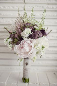 Rustic bouquet with muted mauve and pink tones. Peonies and lavender