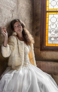 Trash the dress at Corvinilor Castle Romania. Beautiful window light