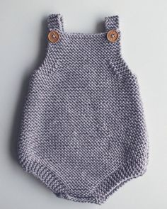 Free Knitting Pattern for Easy Baby Romper - Great beginner pattern. The Eve Romper is a baby playsuit carefully designed to be simple in construction, perfect for a beginner. Knit in garter stitch. Two options for closures.Ravelry: Eve Romper by Pip Beginner Knitting Patterns, Baby Hat Knitting Pattern, Knitting For Beginners, Easy Knitting, Baby All In One, Baby Romper Pattern, Knitted Romper, Garter Stitch, Baby Sweaters