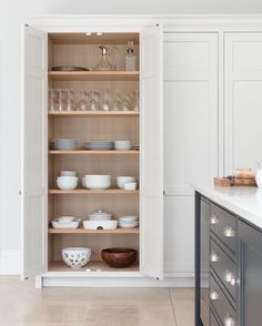 Lots of space for organizing your glassware and servingware closest to the dining table in this cupboard. - Architecture and Home Decor - Bedroom - Bathroom - Kitchen And Living Room Interior Design Decorating Ideas - Kitchen Larder, Kitchen Shelves, Kitchen Storage, Kitchen Dining, Kitchen Decor, Kitchen Cabinets, Kitchen Island, Dining Table, Luxury Kitchens