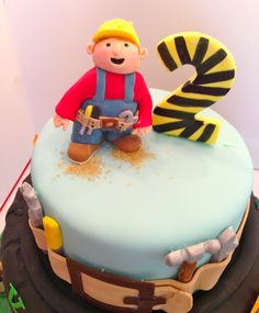 Handsculpted construction guy.  He is dressed with his tool belt full of tools. #Bob the builder # construction cake topper.