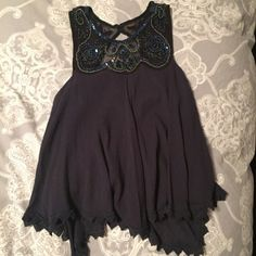 Romantic FP Black and Blue Beaded High Neck Tank Amazing beading at the neckline with a key hole back (closed with two clasps at the top) Such a romantic look, easily paired with anything. Free People Tops