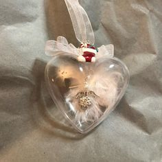 Handmade angel in a bauble encased in a bauble with a bed of feathers with matching colours, with a christmas charm. Available in lots of colours, can also be made in memory of loved ones who have passed away. Christmas Baubles, Christmas Angels, Christmas Gifts, Christmas Tree, Personalised Bauble, Handmade Angels, Gift From Heaven, Baby Memories, Initial Charm