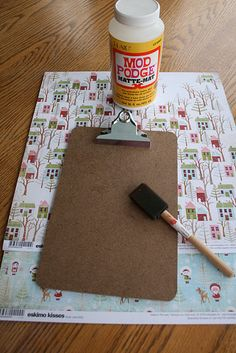 One of the many things I would like to do.  Using Scrapbook paper on a clipboard using Mod Podge paste.