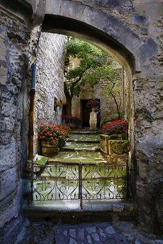 Garden inside a medieval castle nestled in the mountains of Les Baux de Provence, France