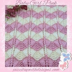 "Extremely soft baby blanket is striped in Pink and Cream.  Hand knit baby blanket is in a beautiful lace and fan pattern with a crochet border and extremly soft to the touch.  This is hand knit in Caron Simply Soft yarn.  Baby blanket is a receiving size in 36"" x 36"" perfect for new borns or toddlers.  Pink and Cream stripes make this a very pretty blanket to see."