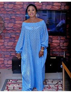 Here is a full view on how to make an off shoulder bubu kaftan with a smoking elastic band Source by DizhaFashion Latest African Fashion Dresses, African Dresses For Women, African Print Fashion, African Attire, African Print Dress Designs, Lace Gown Styles, The Dress, Voici, Short Long Dresses