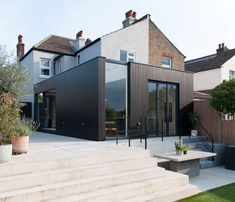 Charcoal House / Yellow Cloud Studio Completed in 2017 in United Kingdom. Charcoal House is as a crisp rectangular corner plot extension clad with black timber wrapped in glazing and set in a concrete landscape that. House Extension Design, Extension Designs, House Design, Extension Ideas, House Cladding, Timber Cladding, Design Exterior, Interior Exterior, Charcoal House