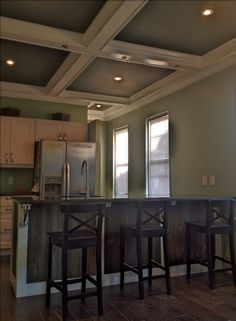 Barn wood kitchen island with IKEA cabinets and Uba Tuba granite countertop and coffered ceiling.