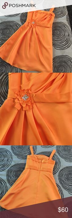 Junior Bridesmaid dress Can be used for junior bridesmaid or just a dress. Beautiful tangerine dress with rhinestone accent. Beautiful silk like material. Great condition. Only worn once and dry cleaned! Dresses Formal