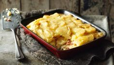 Tartiflette [French-style cheesy potato bake w/pickled onions, gherkins + charcuterie] [BBC Food] Cheesy Potato Bake, Cheesy Potatoes, Tartiflette Recipe, Best Bacon, Gratin Dish, Tacos, Homemade Pickles, Pickled Onions, Potato Recipes