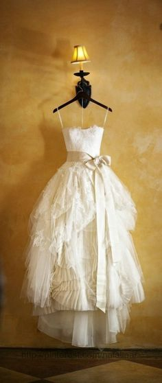 Layers of lace, and tulle, and ruffles on the skirt of this wedding gown photo. I would love to make this for a bride. This is a great rustic wedding gown idea. I would add a pair of cute boots under this dress.