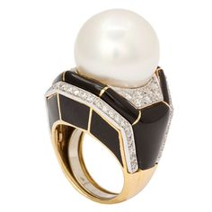 DAVID WEBB. A wonderful large cocktail ring, consisting of a fine South Sea cultured pearl with enamel and diamond. Mounted on 18kt gold and platinum. Circa 1960s
