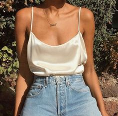 Off white satin camisole & blue jeans