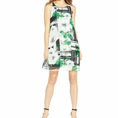 Alfani Dress This dress has a beautiful and fun floral design with just enough color to make it pop. The last picture is of the back of the dress.  If you have any questions feel free to ask. Bundle to save on shipping and to get a discount! Alfani Dresses
