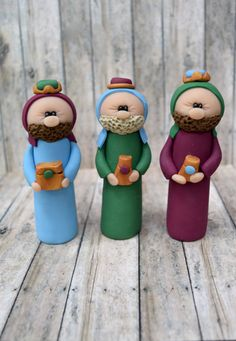 About The Item--------------------------- Three Kings These figures are handmade, created with polymer clay and fired in a conventional oven which gives it a ceramic-like texture. Each is unique; no molds are used.  Figures stand about 4 inches tall.   I love using vibrant colors for the three kings. Please note that the colors may vary based on availability of clay.  Additional figures for your nativity scene: ►Holy Family https://www.etsy.com/listing/260006955/holy-...