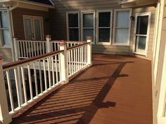 Two tone deck, copper solar lights, solid stain, painted deck rails, chocolate stain