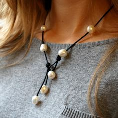 """I love designing items that can be worn more than one way! Wear this handcrafted freshwater pearl and natural leather 4 ways. Versatile, casual and on trend, you'll love wearing this necklace! Also available in black as a separate listing- Handcrafted 17"""" long Materials: Freshwater pearls leather"""