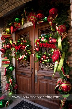 This Merry Christmas Entryway might just be best in show . in the 2013 Texas Christmas House competition. Christmas Entryway, Diy Christmas Garland, Christmas Front Doors, Christmas Porch, Noel Christmas, Outdoor Christmas, Winter Christmas, Office Christmas, Elegant Christmas