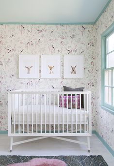 A lovely nursery featuring our Painted Stripe Crib Sheet, stunning wallpaper, and Animal Print Shop prints.