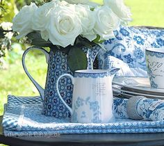 Pretty blue and  white with fresh roses!