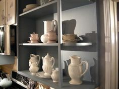 Easy-to-build, open shelving is a great way to display antique dishware. Bookshelf Styling, Bookshelves, Prefab Cabinets, Kitchen Bookshelf, Bench Decor, Modern Floor Lamps, Plates On Wall, Plate Wall, Open Shelving