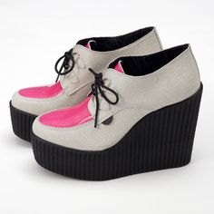 Underground Suede and Pink Neon Wedge Creepers    £125.00       Underground Suede and Neon Pink Wedge Creepers     £125.00     This wedge creeper shoes by Underground has been made with leather upper and a ridged sole, available at 3939 SHOP, London. It features a shocking pink neon paneled design with lace-up closure to the front, an almond shaped toe, a high platform sole and a chunky wedge heel.