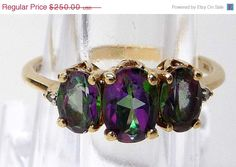 Tax Time Sale Mystic Topaz Vintage Ring - Iridescent Purple & Blue Mystic Topaz 10K gold. $200.00, via Etsy.