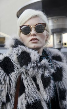 Retro sunglasses and oversized faux fur