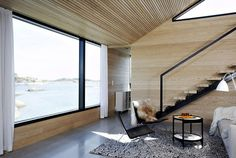Love the contrast of light natural wood and black metal windows