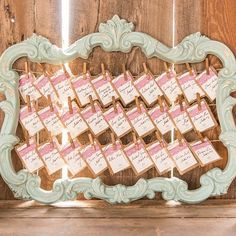 Hang pictures from this ornate vintage frame at your reception for a personable touch.