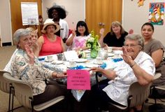 Pinkies up? Pinkies down? It didn't matter...everyone had fun during British trivia and tea. There were some mighty fine hats on display, as well. Take a look.
