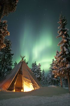 Northern lights and Sami tipi tent Sami Siida, Jukkasjärvi, Swedish Lapland