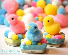 Sweet little chicks sit on top of a mini tin container.