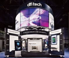 At the center of the booth EWI Worldwide created for DFI Tech at InfoComm 2011 stood a tower of 18 synced screens powered by DFI's M100 Medi... Photo: EMI Worldwide