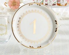 Use these vintage-inspired plate table numbers to guide guests to their seats! | Tea Time Vintage Plate Table Numbers (1-6) | My Wedding Favors
