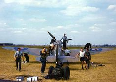 Spitfire with one pilot and nine ground crew getting it ready for it's next sortie - Battle of Britain 1940